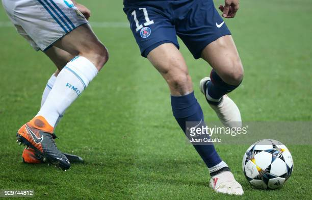 Daniel Carvajal of Real Madrid Angel Di Maria of PSG during the UEFA Champions League Round of 16 Second Leg match between Paris SaintGermain and...
