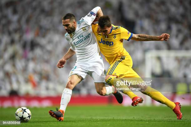 Daniel Carvajal of Real Madrid battles for possesion with Mario Mandzukic of Juventus during the UEFA Champions League Quarter Final Second Leg match...