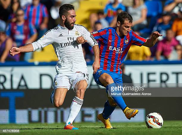 Daniel Carvajal of Real Madrid battles for the ball with Ivan Lopez of Levante during the La Liga match between Levante UD and Real Madrid at Ciutat...