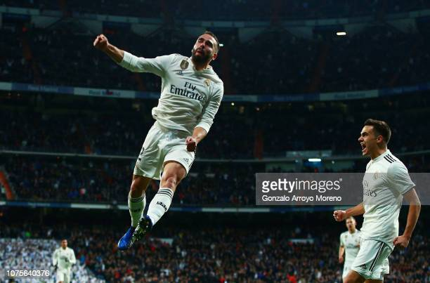 Daniel Carvajal of Real Madrid celebrates as Daniel Wass of Valencia scores an own goal for their first goal during the La Liga match between Real...