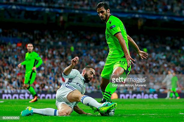 Daniel Carvajal of Real Madrid CF blocks Bryan Ruiz of Sporting CP during the UEFA Champions League group stage match between Real Madrid CF and...