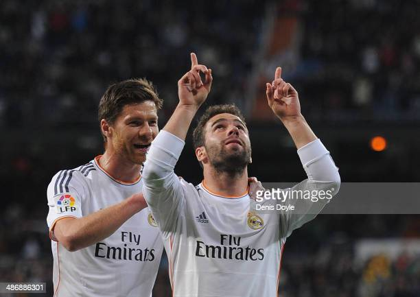 Daniel Carvajal of Real Madrid CF celebrates beside Xabi Alonso after scoring Real's 4th goal from a free kick during the La Liga match between Real...