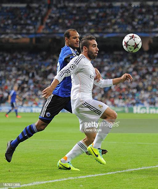 Daniel Carvajal of Real Madrid CF clears the ball ahead of Daniel Braaten of FC Copenhagen during the UEFA Champions League match between Real Madrid...