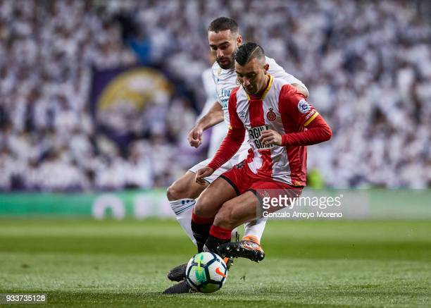 Daniel Carvajal of Real Madrid CF competes for the ball with Borja Garcia of Girona FC during the La Liga match between Real Madrid CF and Girona FC...