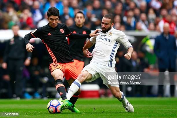 Daniel Carvajal of Real Madrid CF competes for the ball with Carlos Soler of Valencia CF during the La Liga match between Real Madrid CF and Valencia...