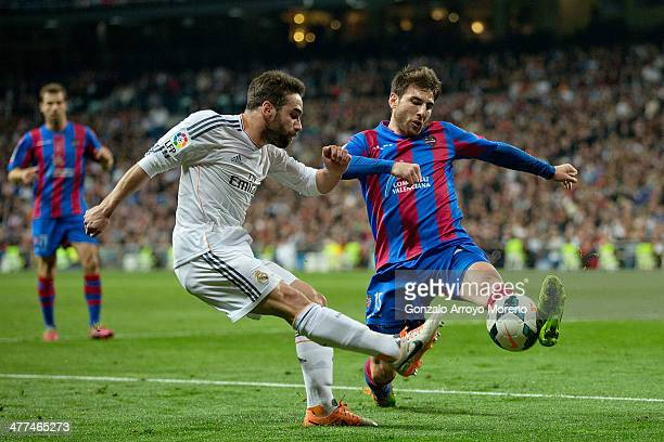 Daniel Carvajal of Real Madrid CF competes for the ball with Nikos Karabelas of Levante UD during the La Liga match between Real Madrid CF and...