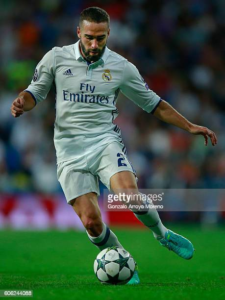 Daniel Carvajal of Real Madrid CF controls the ball during the UEFA Champions League group stage match between Real Madrid CF and Sporting Clube de...