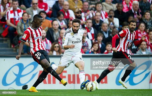 Daniel Carvajal of Real Madrid CF duels for the ball with Inaki Willams of Athletic Club Bilbao during the La Liga match between Athletic Club Bilbao...