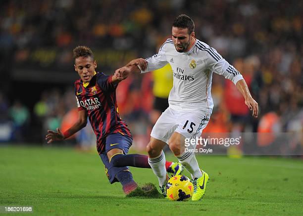 Daniel Carvajal of Real Madrid CF is tackled by Neymar of FC Barcelona during the La Liga match between FC Barcelona and Real Madrid CF at Camp Nou...