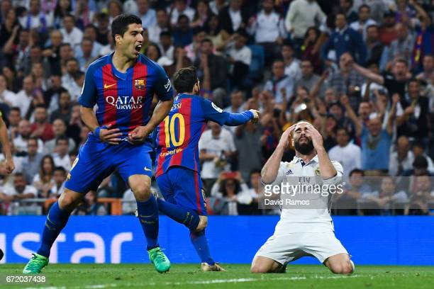 Daniel Carvajal of Real Madrid CF reacts as Lionel Messi of FC Barcelona celebrates after scoring his team's third goal during the La Liga match...