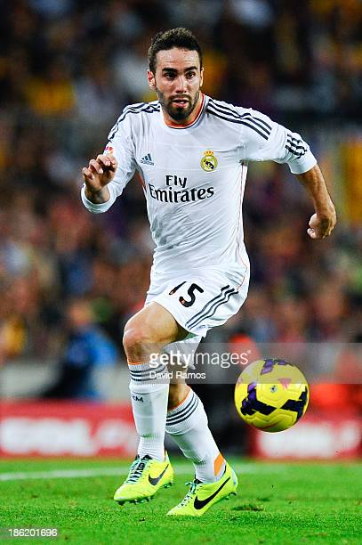 Daniel Carvajal of Real Madrid CF runs with the ball during the La Liga match between FC Barcelona and Real Madrid CF at Camp Nou on October 26 2013...