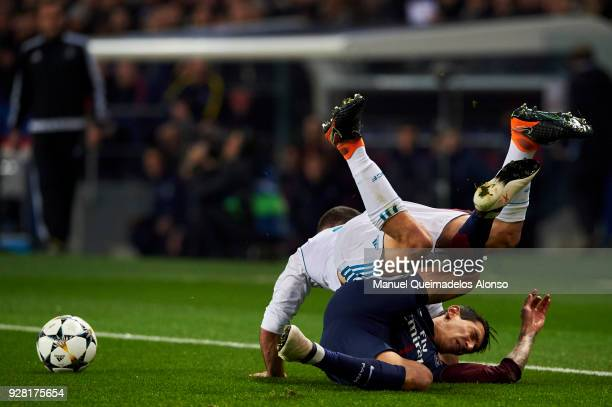 Daniel Carvajal of Real Madrid competes for the ball with Angel Di Maria of Paris SaintGermain during the UEFA Champions League Round of 16 Second...