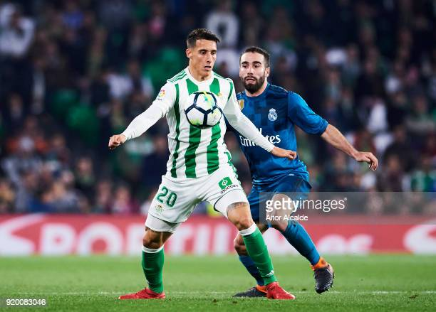 Daniel Carvajal of Real Madrid competes for the ball with Cristian Tello of Real Betis during the La Liga match between Real Betis and Real Madrid at...