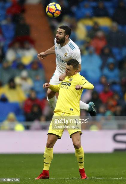 Daniel Carvajal of Real Madrid competes for the ball with Denis Cheryshev of Villarreal during the La Liga match between Real Madrid and Villarreal...