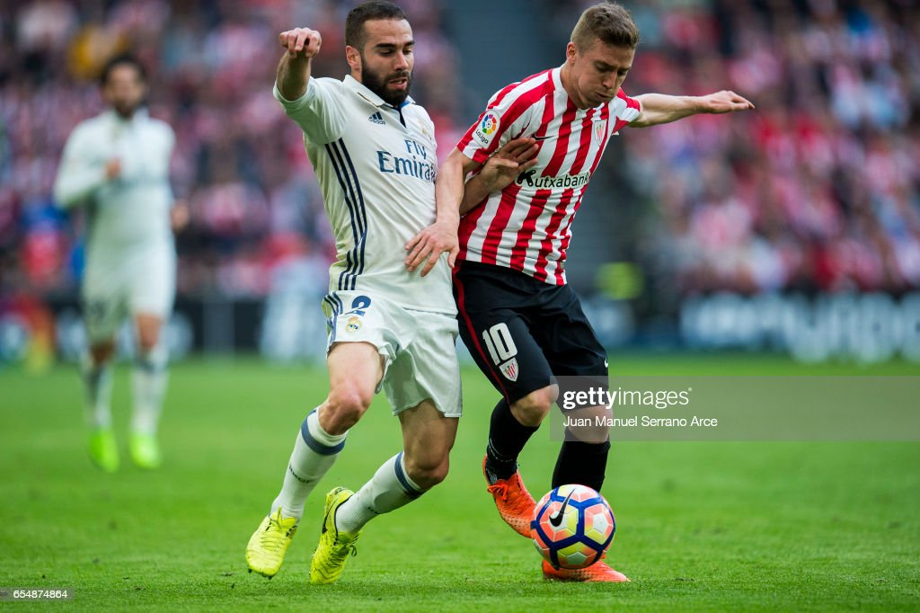 Daniel Carvajal of Real Madrid competes for the ball with Iker Muniain of Athletic Club during the La Liga match between Athletic Club Bilbao and Real Madrid at San Mames Stadium on on March 18, 2017 in Bilbao, Spain.