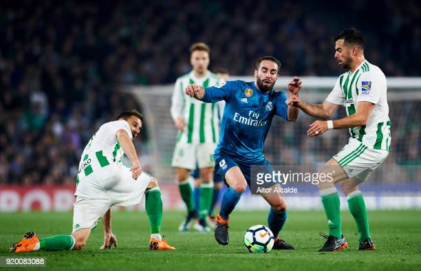 Daniel Carvajal of Real Madrid competes for the ball with Jordi Amat of Real Betis during the La Liga match between Real Betis and Real Madrid at...
