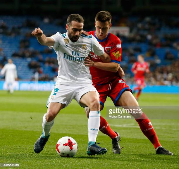 Daniel Carvajal of Real Madrid competes for the ball with Saul Garcia of Numancia during the Copa del Rey round of 16 second leg match between Real...