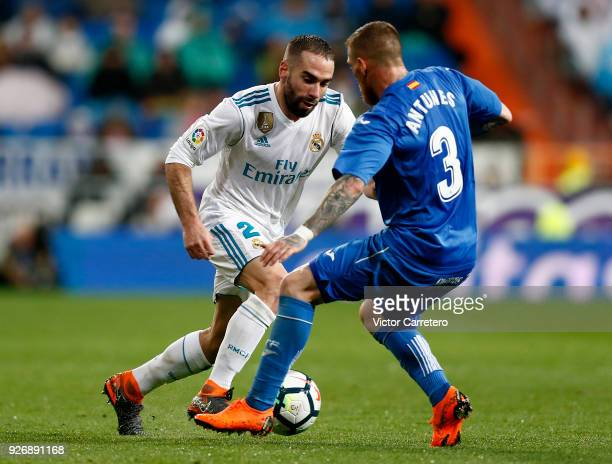 Daniel Carvajal of Real Madrid competes for the ball with Vitorino Antunes of Getafe during the La Liga match between Real Madrid and Getafe at...