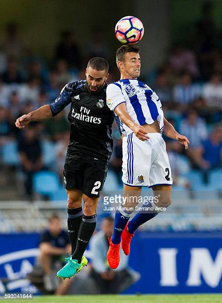 Daniel Carvajal of Real Madrid duels for the ball with David Concha of Real Sociedad during the La Liga match between Real Sociedad de Futbol and...