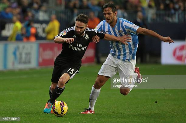 Daniel Carvajal of Real Madrid duels for the ball with Roque Santa Cruz of Malaga CF during the La Liga match between Malaga CF and Real Madrid CF at...