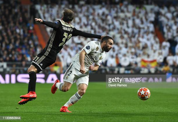 Daniel Carvajal of Real Madrid evades Nicolas Tagliafico of Ajax during the UEFA Champions League Round of 16 Second Leg match between Real Madrid...