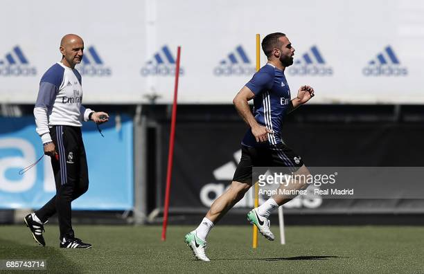 Daniel Carvajal of Real Madrid exercises with physical trainer Antonio Pintus during a training session at Valdebebas training ground on May 20 2017...