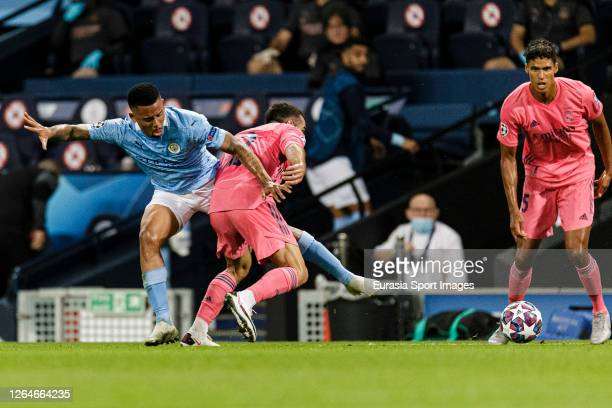 Daniel Carvajal of Real Madrid fights for the ball with Gabriel Jesus of Manchester City during the UEFA Champions League round of 16 second leg...