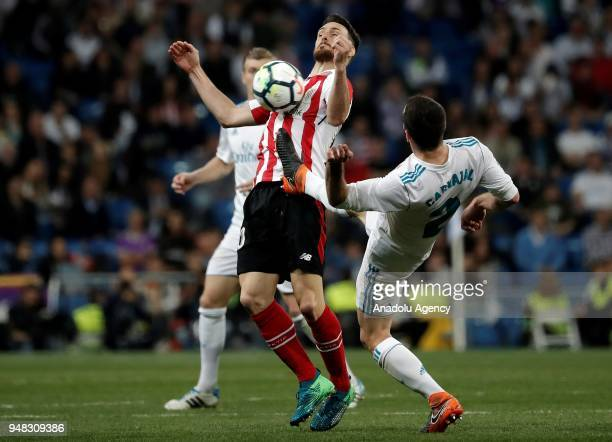 Daniel Carvajal of Real Madrid in action against Aritz Aduriz of Athletic Bilbao during the La Liga soccer match between Real Madrid and Athletic...