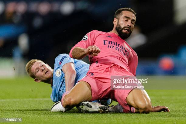 Daniel Carvajal of Real Madrid is challenged by Kevin De Bruyne of Manchester City during the UEFA Champions League round of 16 second leg match...