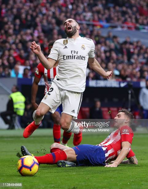 Daniel Carvajal of Real Madrid is challenged by Lucas Hernandez of Atletico Madrid during the La Liga match between Club Atletico de Madrid and Real...