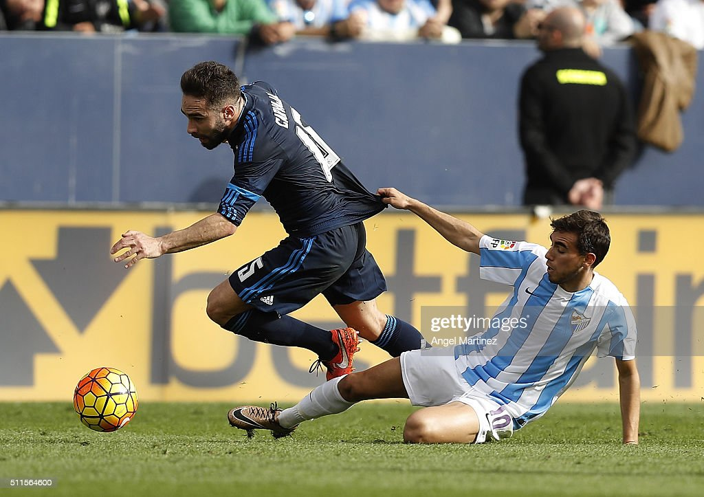 Daniel Carvajal of Real Madrid is chased by Ricardo Horta of Malaga CF during the La Liga match between Malaga CF and Real Madrid CF at La Rosaleda Stadium on February 21, 2016 in Malaga, Spain.