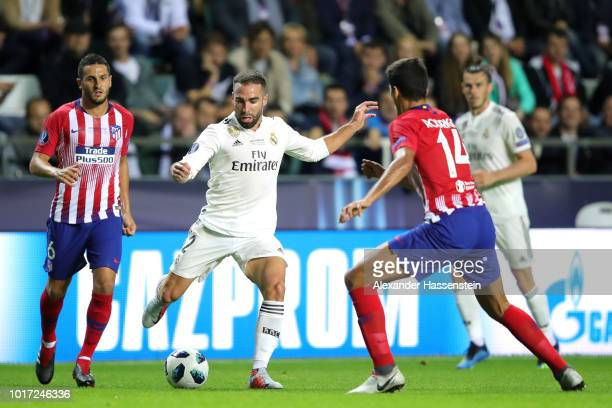 Daniel Carvajal of Real Madrid is closed down by Rodri of Atletico Madrid during the UEFA Super Cup between Real Madrid and Atletico Madrid at...