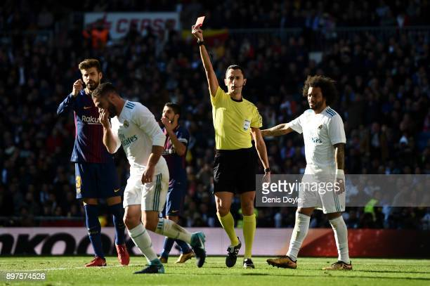 Daniel Carvajal of Real Madrid is shown a red card by referee Jose Maria Sanchez during the La Liga match between Real Madrid and Barcelona at...