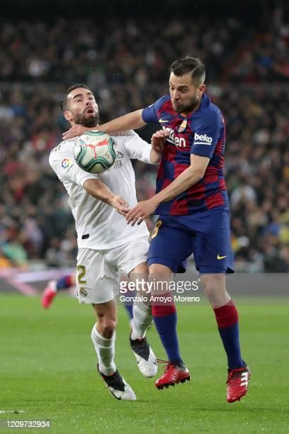 Daniel Carvajal of Real Madrid is tackled by Jordi Alba of FC Barcelona during the Liga match between Real Madrid CF and FC Barcelona at Estadio...