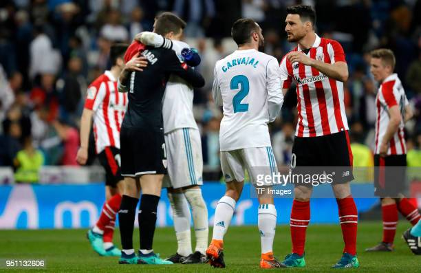 Daniel Carvajal of Real Madrid Kepa of Athletic Club and Aduriz of Athletic Club gesture after the La Liga match between Real Madrid and Athletic...