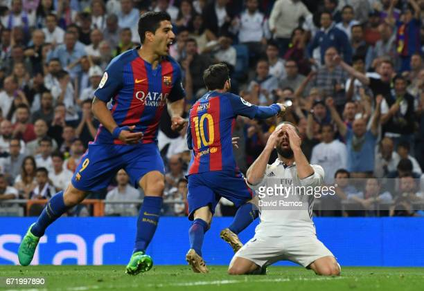 Daniel Carvajal of Real Madrid reacts as Lionel Messi of Barcelona scores their third goal during the La Liga match between Real Madrid CF and FC...