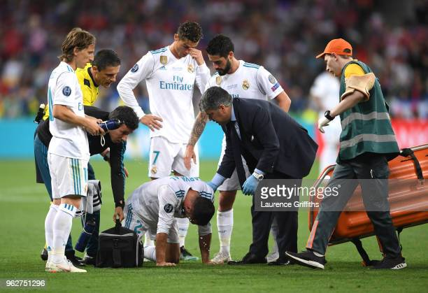 Daniel Carvajal of Real Madrid recieves medical treatment during the UEFA Champions League Final between Real Madrid and Liverpool at NSC Olimpiyskiy...