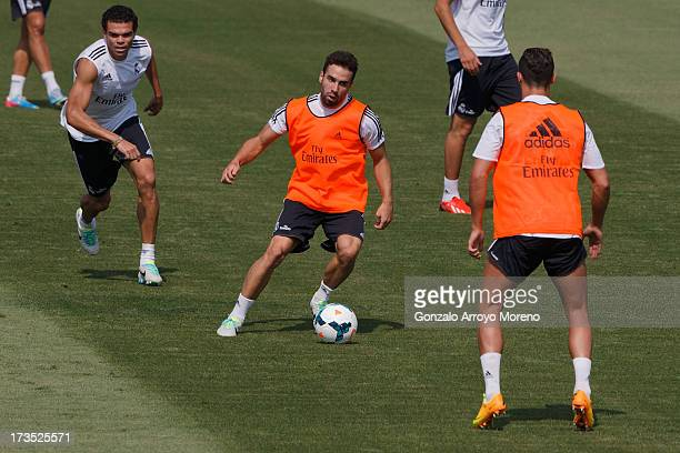Daniel Carvajal of Real Madrid runs with the ball during a training session at the Valdebebas training ground on July 16 2013 in Madrid Spain
