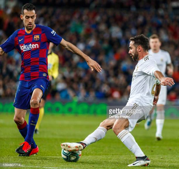 Daniel Carvajal of Real Madrid Sergio Busquets of FC Barcelonabattle for the ball during the Liga match between Real Madrid CF and FC Barcelona at...