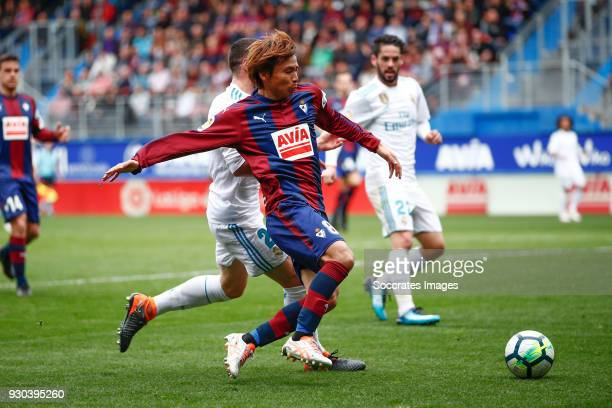 Daniel Carvajal of Real Madrid Takashi Inui of SD Eibar during the La Liga Santander match between Eibar v Real Madrid at the Estadio Municipal de...