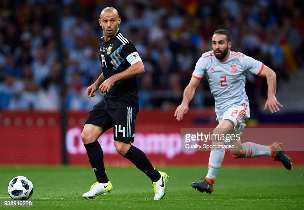 Daniel Carvajal of Spain chases down Javier Mascherano of Argentina during the international friendly match between Spain and Argentina at Wanda...