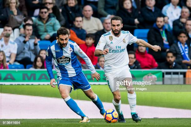 Daniel Carvajal Ramos of Real Madrid competes for the ball with Adrian Lopez Alvarez of RC Deportivo La Coruna during the La Liga 201718 match...