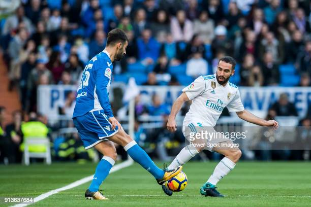 Daniel Carvajal Ramos of Real Madrid fights for the ball with Adrian Lopez Alvarez of RC Deportivo La Coruna during the La Liga 201718 match between...