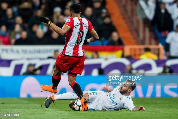 Daniel Carvajal Ramos of Real Madrid fights for the ball with Johan Andres Mojica Palacio of Girona FC during the La Liga 201718 match between Real...