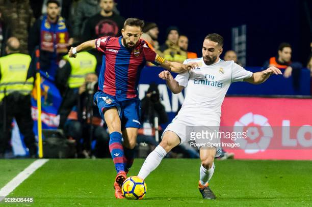 Daniel Carvajal Ramos of Real Madrid fights for the ball with Jose Luis Morales Nogales of Levante UD during the La Liga 201718 match between Levante...