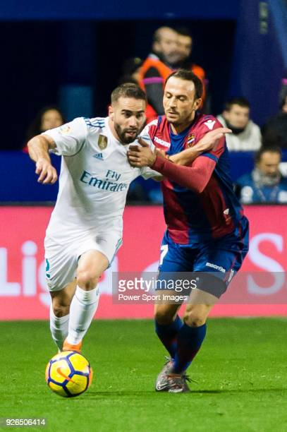 Daniel Carvajal Ramos of Real Madrid fights for the ball with Giampaolo Pazzini of Levante UD during the La Liga 201718 match between Levante UD and...