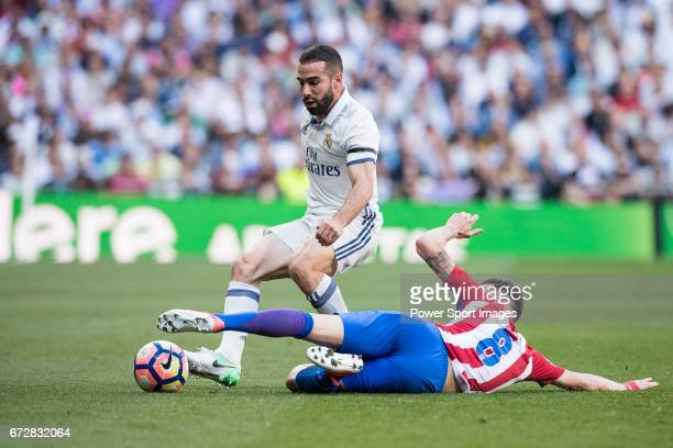 Daniel Carvajal Ramos of Real Madrid fights for the ball with Saul Niguez Esclapez of Atletico de Madrid during their La Liga match between Real...