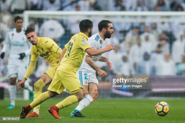 Daniel Carvajal Ramos of Real Madrid is tackled by Jaume Vicent Costa Jorda J Costa and Samuel Castillejo Azuaga Samu Castillejo of Villarreal CF...