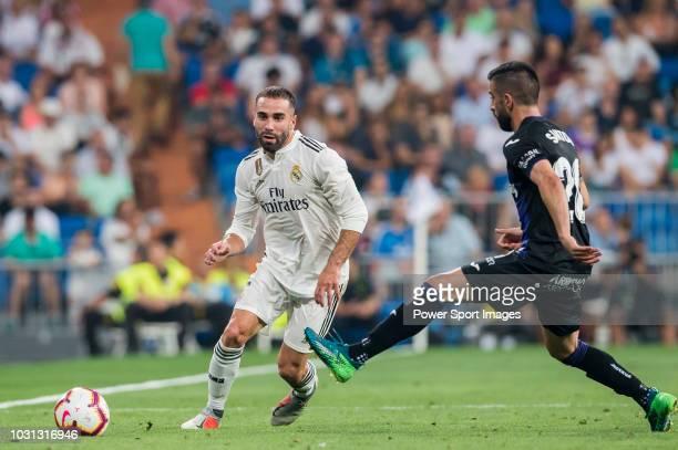 Daniel Carvajal Ramos of Real Madrid is tackled by Michael Nicolas Santos Rosadilla of CD Leganes during the La Liga match between Real Madrid CF and...