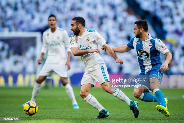 Daniel Carvajal Ramos R of Real Madrid fights for the ball with Florin Andone of RC Deportivo La Coruna during the La Liga 201718 match between Real...